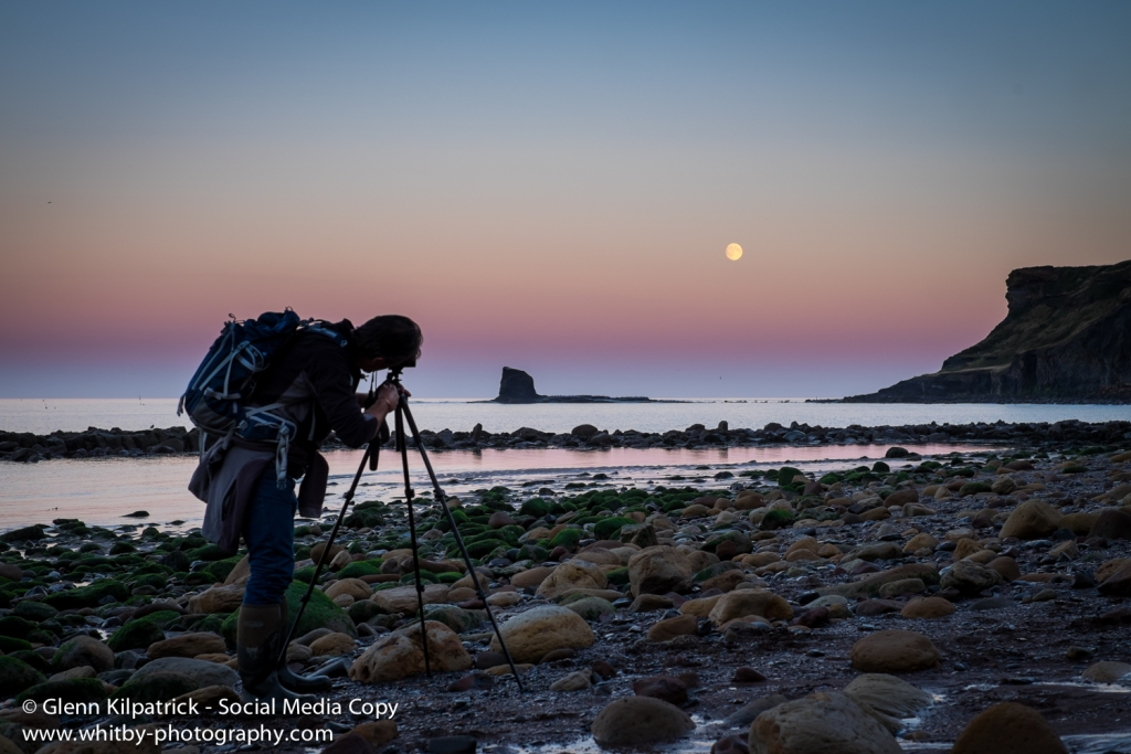 Mike Marshall photographing the moon rising over Saltwick Sisters.