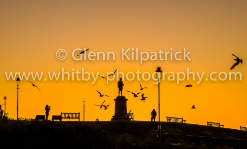 Sunset At Captain Cooks Statue In Whitby