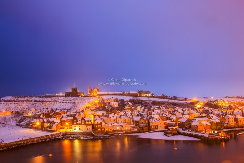The Lower Harbour At Whitby With Snow Overs The Beach And Rooftops Of the Town.