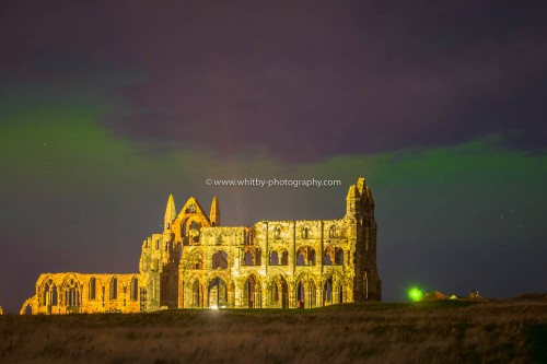 The Northern Lights Over Whitby Abbey In North Yorkshire.