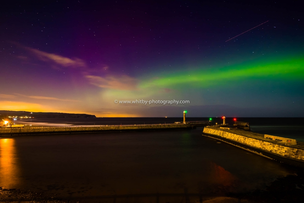 Northern Lights Over Whitby Piers, Shot From The Haggerlythe Over Looking Whitby East Pier.