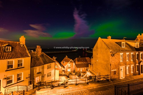 The Whitby 199 Steps With Northern Lights Shining Over the Piers.