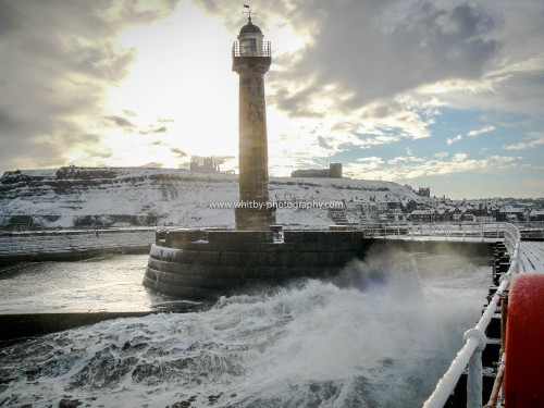 Whitby West Pier LightHouse With A Snowy Whitby In The Backdrop