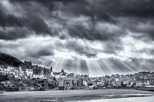The Sunsrays Hit East Whitby. Sandside And Tate Hill Beach In the Foreground