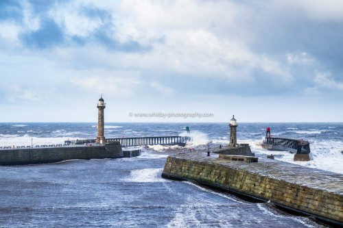 A Huge Wave Goes Straight Over the Top Of Whitby West Pier. Taken From The Haggerlythe