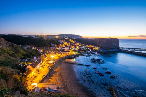 Staithes Village At Dusk.