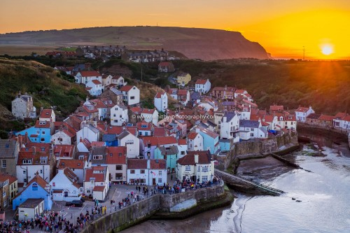 Staithes Village With A Sunset Over Boulby Cliffs