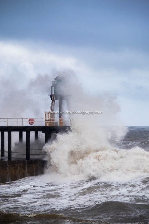 Not Often Do you See A Wave Go Straight Over The Top Of The West Pier Lighthouse.