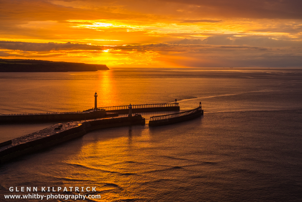 Whitby Sunset Into The Sea - Overlooking Whitby Piers.
