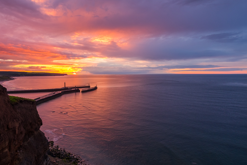 Sunset Into The Sea Looking Over Whitby Piers
