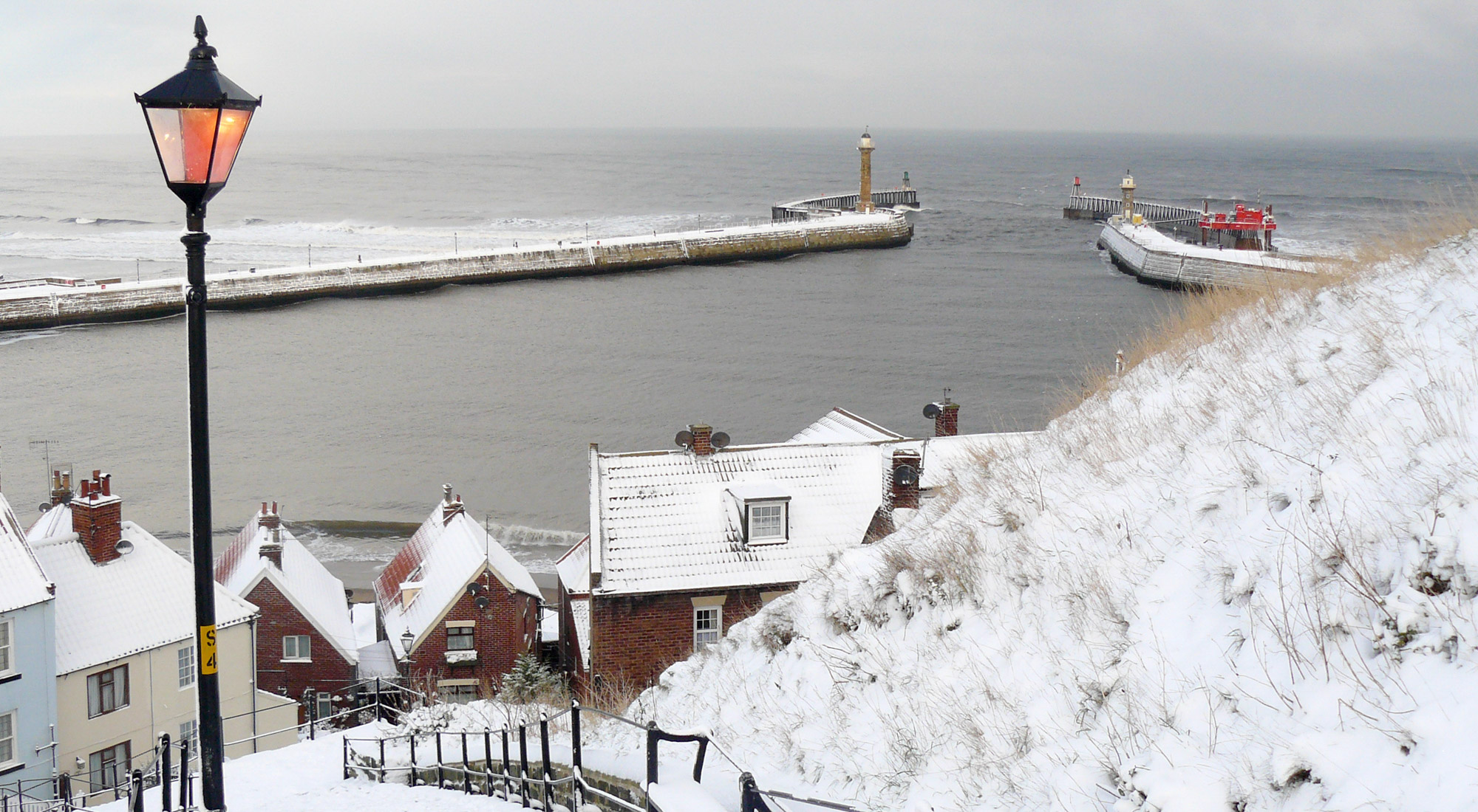A Christmas Card Of Whitby Piers In The Snow Taken From The 199 Steps