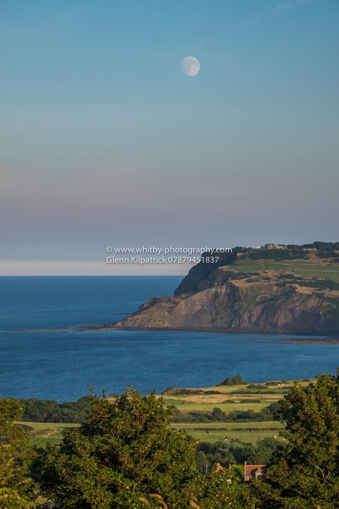 Robin Hoods Bay - A View Of Ravenscar At Moonrise