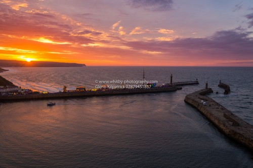 Whitby Piers During A Regatta Sunset