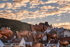 Steve Iredale's Shoal Of Fish, Set beautifully Against the Clouds Lit By A Sunset In The Western Sky.
