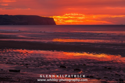 Sunset On Whitby Beach With Reflections