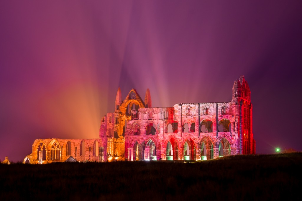 Whitby Abbey With Pinks, purples And Orange. Illuminated Abbey At Whitby