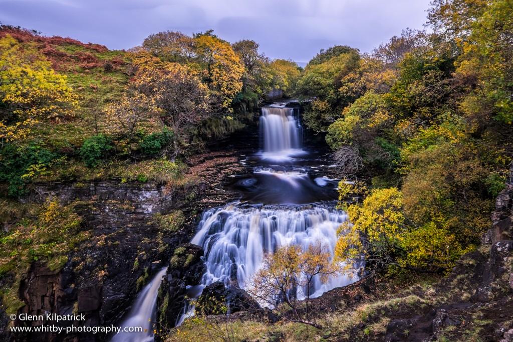 A Waterfall Is N Upwards On The Isle Of Skye