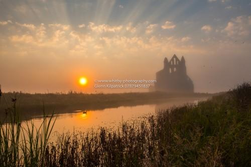 A Misty Sunset Over Whitby Abbey