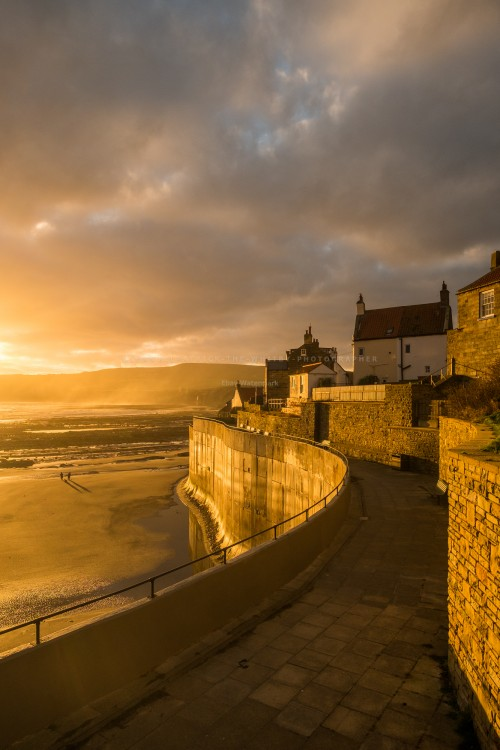 Sunrise At Robin Hoods Bay Sea Wall.