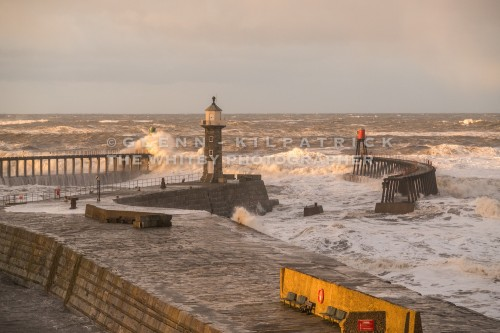 Twenty Five Foot Waves Batter the Piers At Whitby During the Storm Surge Of January 2017.