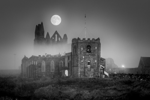 Hunters Moon Rising Over A Misty Whitby Abbey. September 2016