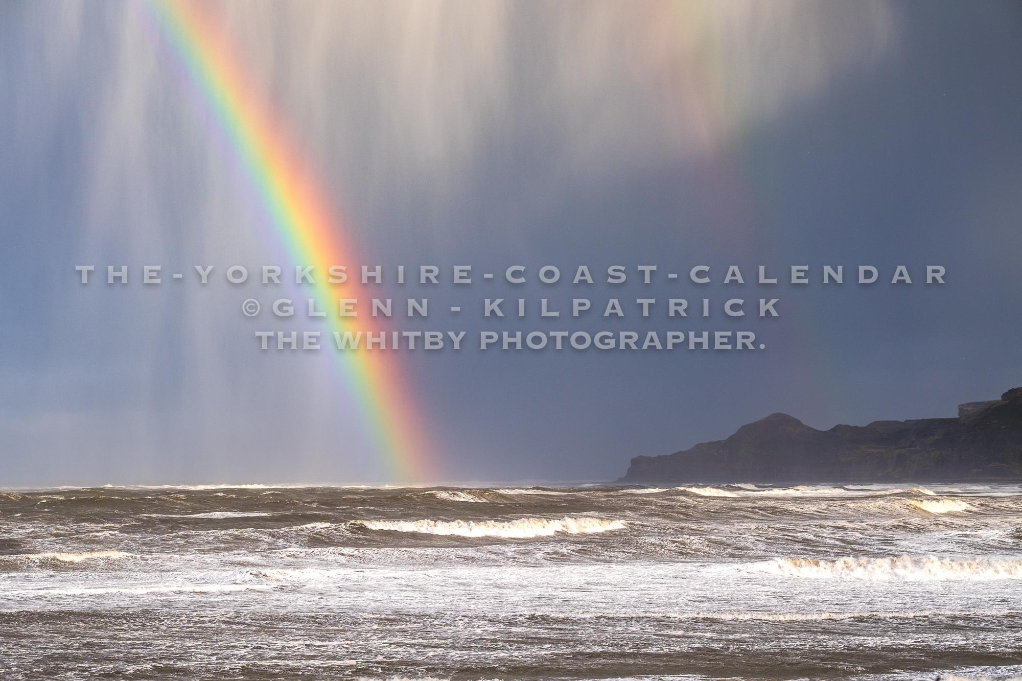 Rainbow Shines Through Stormy Skies At Kettleness - The Yorkshire Coast Calendar 2018 By Glenn Kilpatrick.