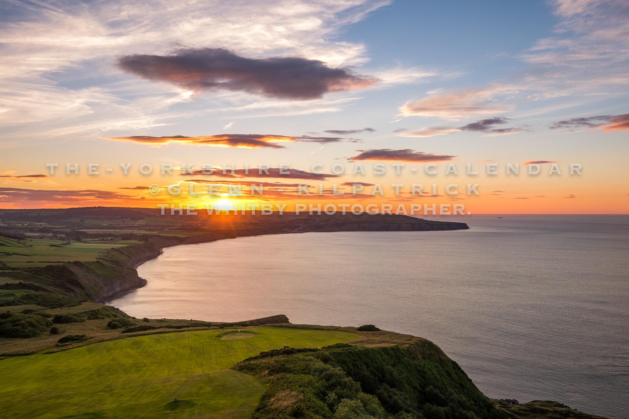 Sunset Over Robin Hoods Bay. Taken From Ravenscar - The Yorkshire Coast Calendar 2018 By Glenn Kilpatrick.