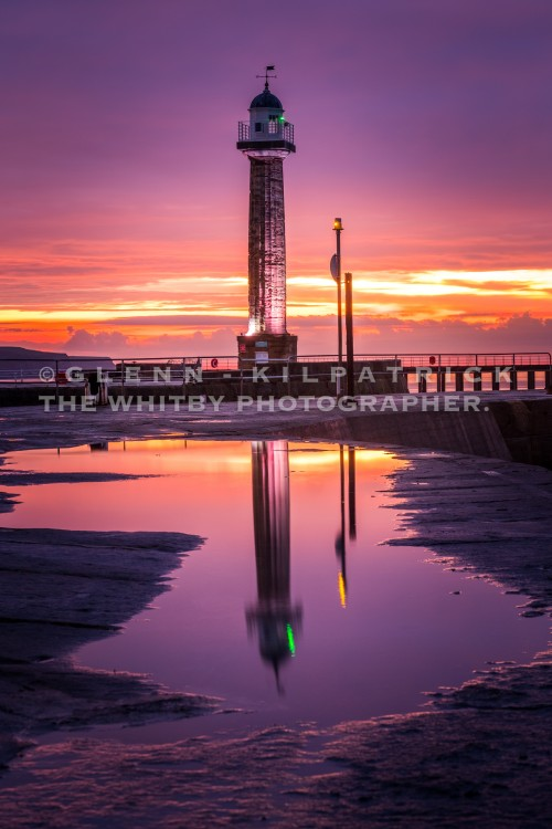 Whitby West Pier Lighthouse With East Pier Reflections