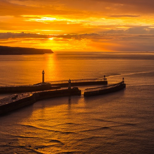 Midsummer Sunset At Whitby Piers