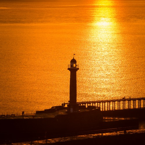 Whitby Lighthouse At Sunset