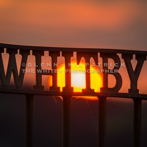 Whitby Storm Gate With Setting Sun Behind