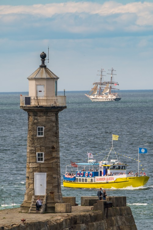 Summer Queen At Whitby Lighthouse With The Tall Ship Stavros S Niarchos In The Back Ground