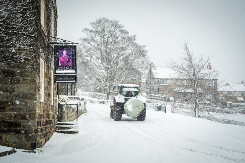 Tractor Driving Through Danby Village In The Snow. North York Moors Snow Scene At Danby Village (1 of 1)
