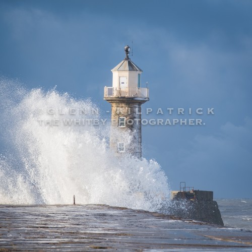 Whitby In The Snow, East Pier Waves With Snow On The Lighthouse