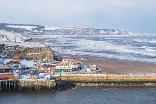 A View Of West Cliff And Sandsend Cliff - Whitby In The Snow - Snowing At Whitby