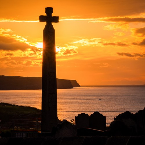 Whitby Coasters - Caedmons Cross At Sunset