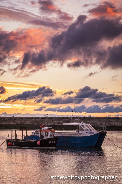 A Stunning Sunset With Two Cobbles In Staithes Harbour Near Whitby