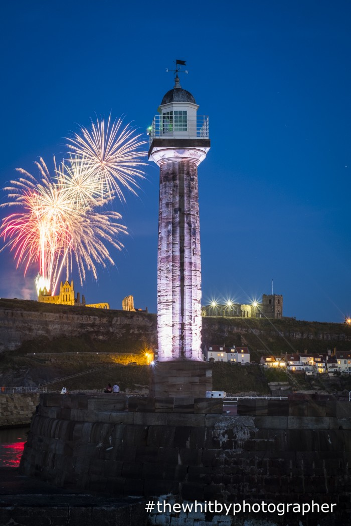 Fireworks Over Whitby Abbey With West Pier Lighthouse In The Foreground
