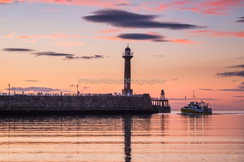 Whitby Harbour With Sunset Cruise Boat Returning Home